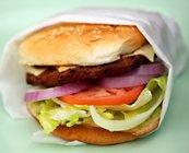 cheese burger with lettuce, tomato and onoin