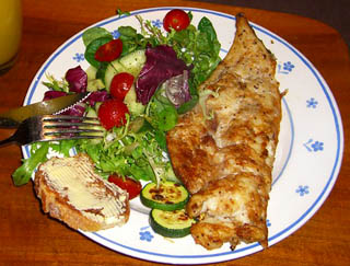 Grilled haddock with fresh herbs and cherry tomato