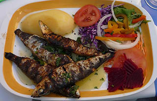 Grilled Sardine with potatoes and other vegetables