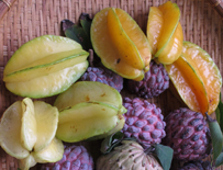 star fruits and custard apples in a market