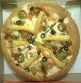 pizza with baby corn, black olives, jalapenos topping