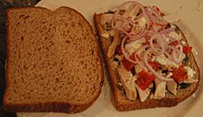sandwich topped with fresh shallots